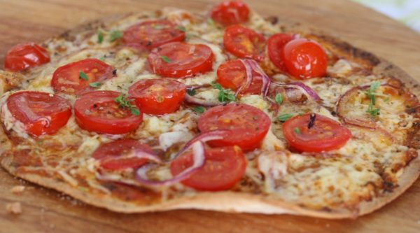 tortilla pizza with rosa tomatoes and red onions
