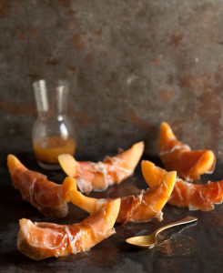parma ham wrapped melon with a honey and wholegrain mustard vinaigrette