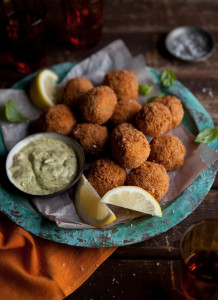 crispy fried roasted tomato risotto balls with smoked mussels