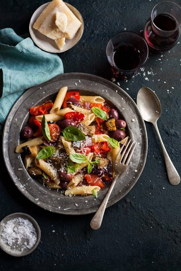 roasted tomato and red pepper pasta with aubergine and olives