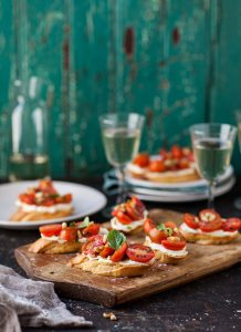 tomato and basil crostini with whipped goats cheese