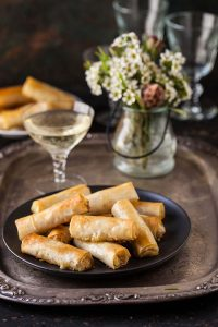 caramelised pear and gorgonzola cigars in phyllo canape