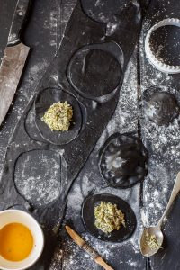 squid ink ravioli with broccoli and ricotta
