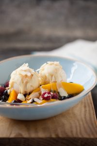 mango split with passionfruit, berries and coconut