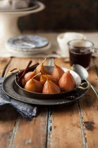 brown sugar pavlova with pears poached in spicy muscadel