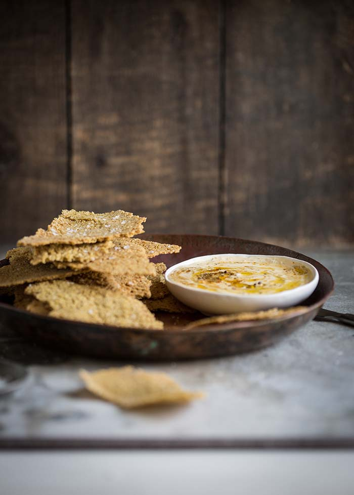 Dan Barbers one - ingredient whole grain cracker with a chermoula creme fraiche dip