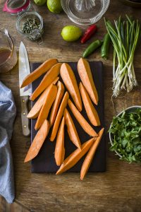 Roast sweet potato wedges with coriander dressing & spicy lime yoghurt   DrizzleandDip.com