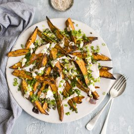 Roast sweet potato wedges with coriander dressing & spicy lime yoghurt | DrizzleandDip.com