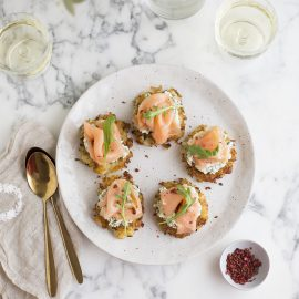 smoked salmon potato cakes with herbed cream & pink peppercorns