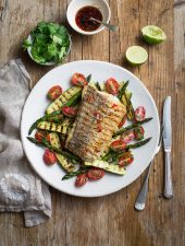 Grilled soy and lime hake with charred greens, fresh tomato & a chili dressing