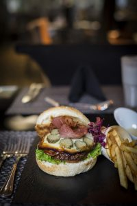 A gourmet burger at Protea Hotel Fire & Ice! by Marriott® Johannesburg Melrose Arch