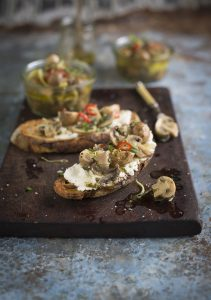 A delicious recipe for pickled mushrooms with fresh herbs, garlic & lemon