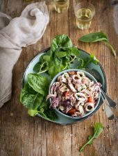 A delicious calamari salad with tomatoes, olives & lemon