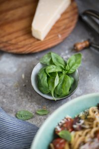 A recipe for a delicious summer pasta with tomato, olives, anchovy, basil & lemon