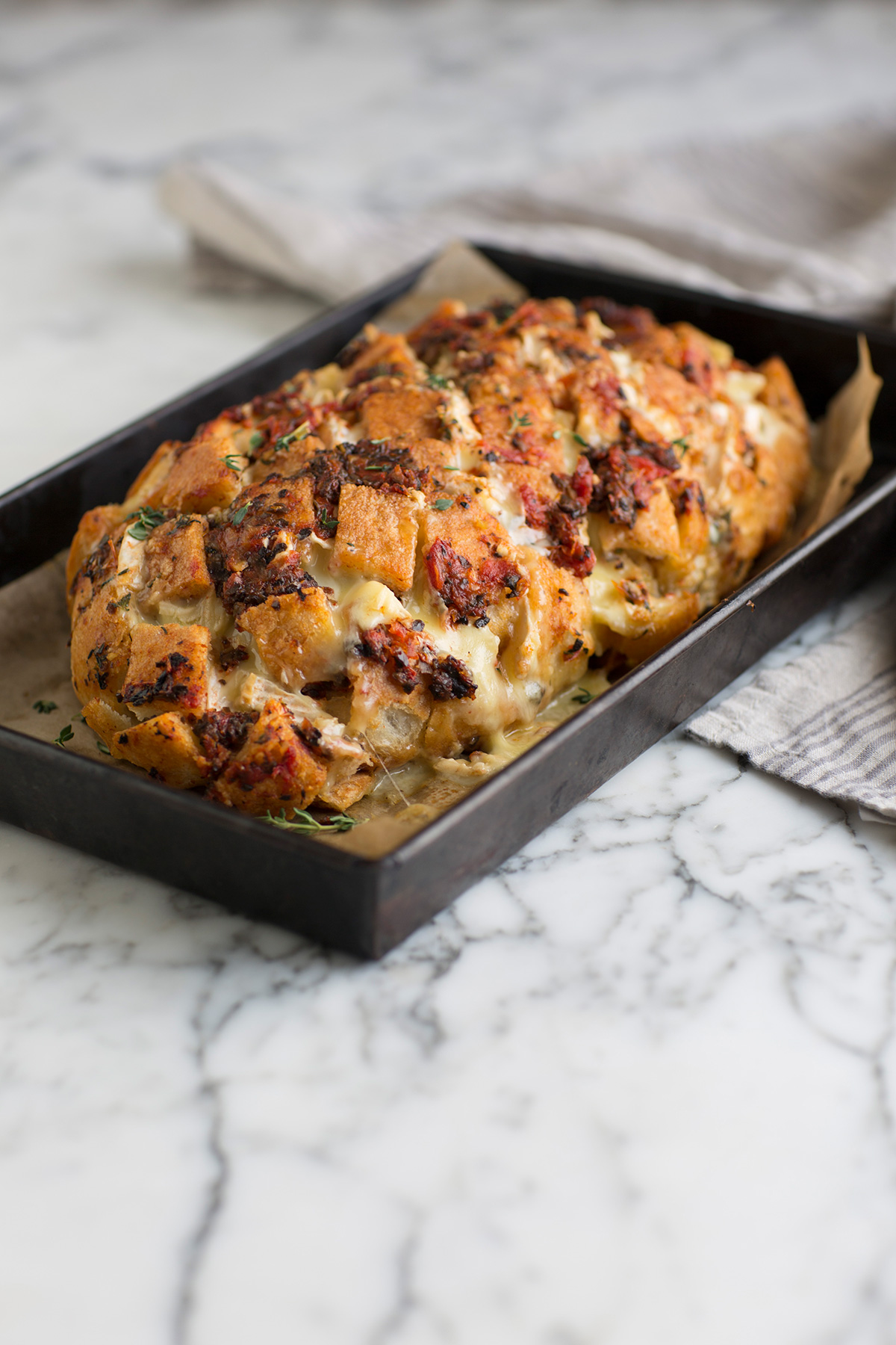 A delicious pull apart bread with Brie & sun-dried tomatoes