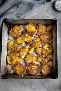 Crispy roasted new potatoes with miso & chive sour cream recipe