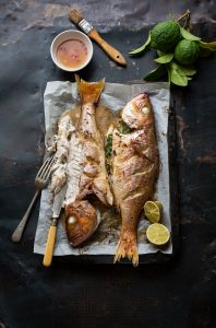 Whole roasted silverfish with Asian flavours, nuoc cham & a green papaya salad