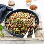 Nutty black & white rice salad with peppers & raisins & a ginger, soy & honey dressing recipe