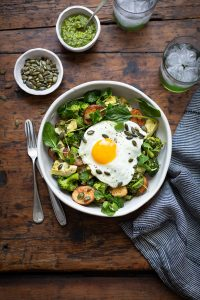 Warm salad with broccoli, new potatoes, artichoke, pesto & egg recipe